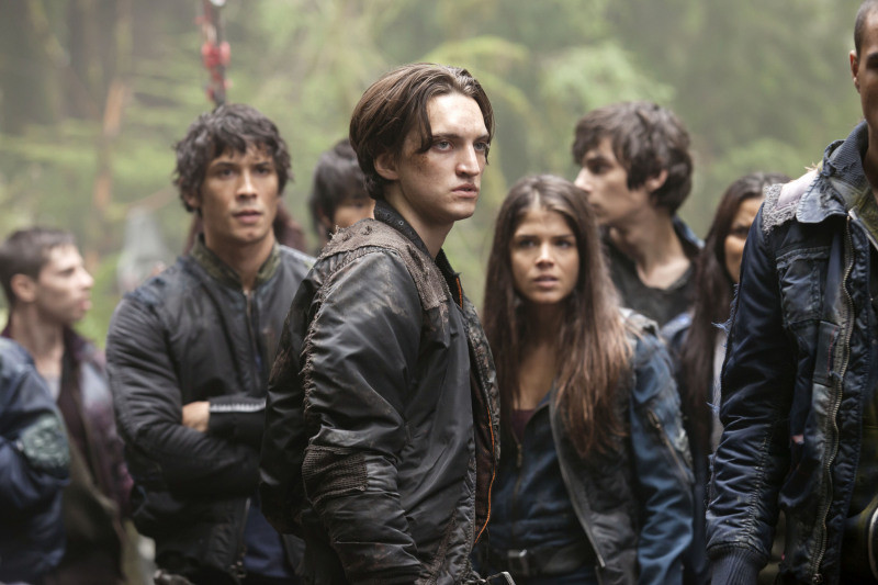 "The 100 --  ""Murphy's Law"" -- Image: HU104b_0160 -- Pictured (L-R): Bob Morley as Bellamy, Richard Harmon as Murphy, Marie Avgeropoulos as Octavia, and Chris Larkin as Monty -- Photo: Katie Yu/The CW -- © 2014 The CW Network, LLC. All Rights Reserved"